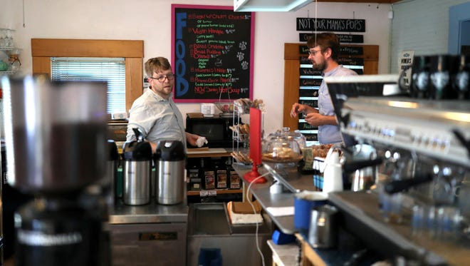 Emile Boghos of Black Dog Cafe works behind the counter at the Railroad Square location on Thursday, Nov. 2, 2017. The company will be celebrating its 20-year-anniversary this month.