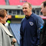 Amy Adams Strunk, Titans interim head coach Mike Mularkey and Kenneth Adams IV chat before the Titans played the Jaguars at Nissan Stadium on Sunday.