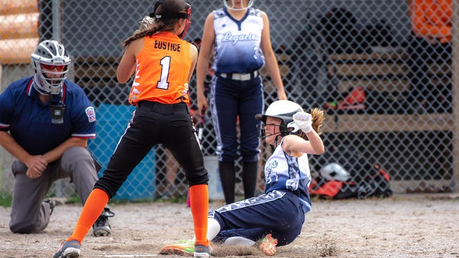 Hailee O'Connor of the Soo Legacies slides into home plate.