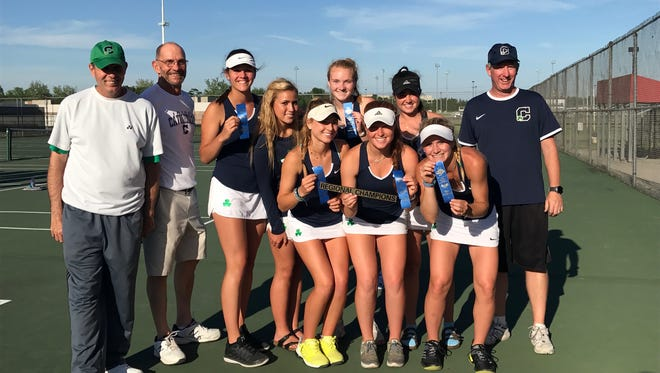 Cathedral girls tennis team celebrate their regional title win over Hamilton Southeastern.