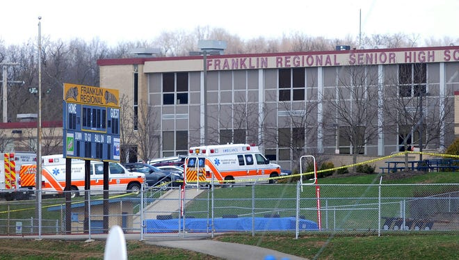 Ambulances are lined up outside Franklin Regional Senior High School following a stabbing spree by a reported 16-year-old student which injured twenty students and staff at the school in Murrysville, Pennsylvania.