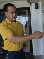 Jesse Garcia, former acting director of the Chamorro Land Trust Commission, points to a list of processed applications posted outside the Land Trust's office in Hagatna in this 2009 file photo.  Processed applications: Jesse Garcia, acting director of the Chamorro Land Trust Commission, points to a list of recently processed applications posted outside the Land Trust's office in Hagåtña.  MUG USED: 05/26/2009
