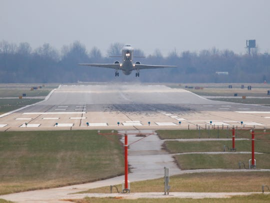 An American Eagle plane takes off on runway 14/32 at
