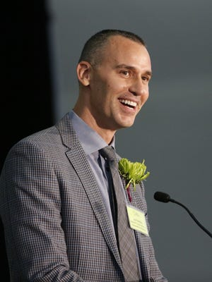 Josh Meibos, physical-education teacher at David Crockett Elementary School, speaks after winning the Arizona Educational Foundation's 2018 Teacher of the Year award in Phoenix on Nov. 7, 2017.