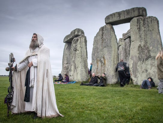 A Druid Merlin participates in rituals outside Stonehenge