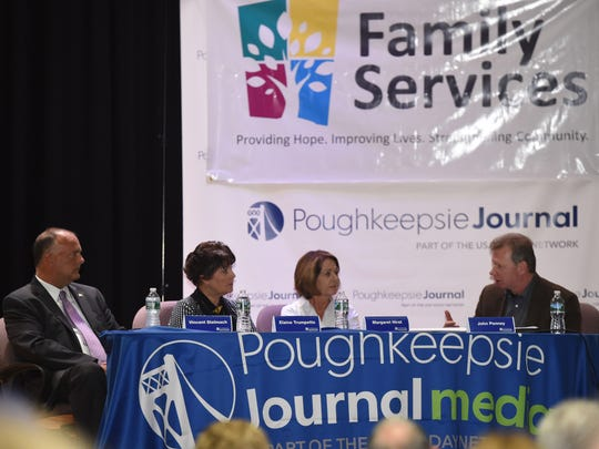 Panelists, from left, Vincent Stelmach, Elaine Trumpetto, Margaret Hirst and John Penney at the Poughkeepsie Journal Media Heroin Forum at the Family Partnership Center in the City of Poughkeepsie on Wednesday.
