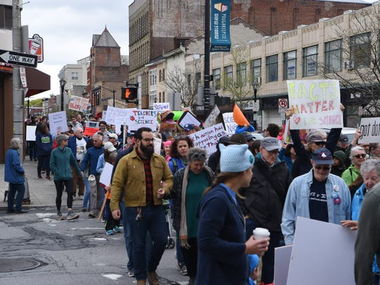 Participants in the Hudson Valley March for Science begin to march down Main Street in the City of Poughkeepsie.