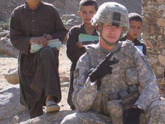 U.S. Army Staff Sgt. Joshua Berry, shown here serving in Afghanistan, served overseas and was shot at during the Fort Hood, Texas, shootings in 2009. Berry took his own life in February 2013 and was being treated for post-traumatic stress disorder.