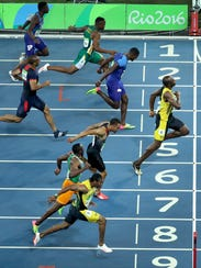 Usain Bolt edges out Justin Gatlin to win the Men's