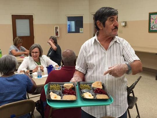 Vinny Lombardo helps serve meals five days a week at one of Aging Matters in Brevard's Seniors at Lunch sites.