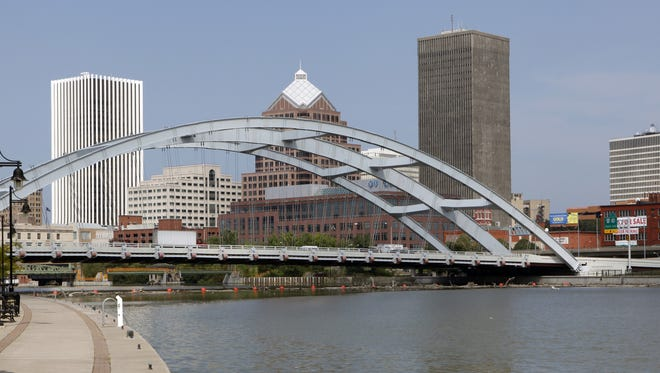 The Frederick Douglass – Susan B. Anthony Memorial Bridge spans the Genesee River in Rochester, NY.