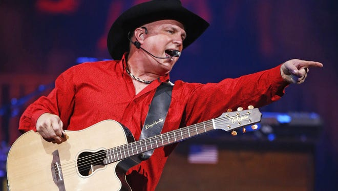 Garth Brooks performs during his world tour on Oct. 16, 2015, at Talking Stick Resort Arena in Phoenix.