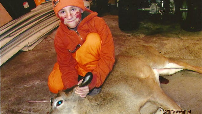 Chase Marquardt of Francis Creek shows the nubby buck he shot during the muzzleloader season near Kellnersville. This was Chase's first deer and he was hunting with his dad, Mannon, as part of a mentored hunt.