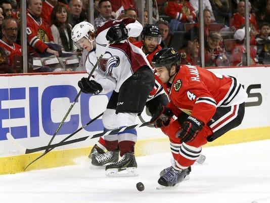 -Avalanche_Blackhawks_Hockey_CXA107.jpg_20140304.jpg