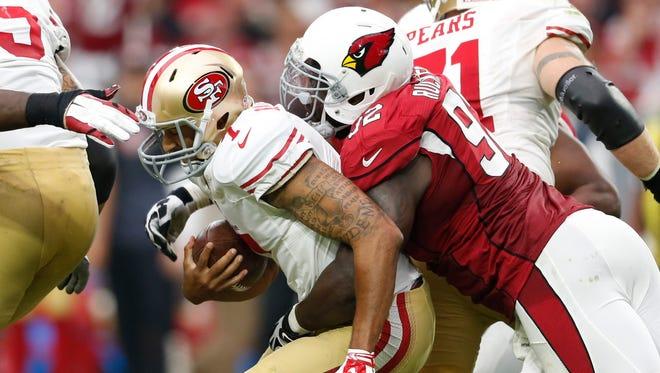 Arizona Cardinals defensive tackle Frostee Rucker sacks San Francisco 49ers quarterback Colin Kaepernick in the third quarter during NFL action at University of Phoenix Stadium in Glendale on September 27, 2015.