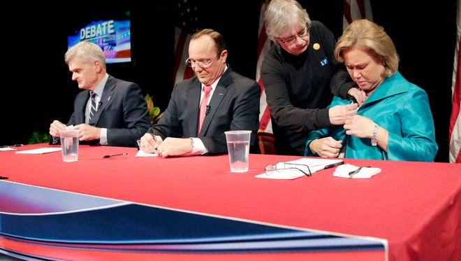 Sen. Mary Landrieu (right), D-La., Senate candidate, Rep. Bill Cassidy (left_, R-La., and Republican candidate Rob Maness prepare for their debate at Centenary College in Shreveport Tuesday.