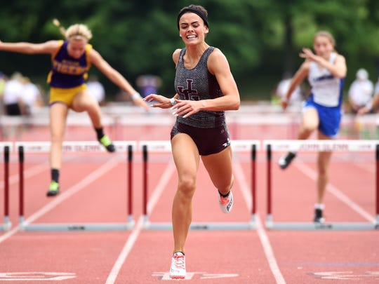 Karlie Zumbro, of John Glenn, runs to win in the 300-meter hurdles during a Division II regional track meet on Saturday, May 26, 2018, at Muskingum University.