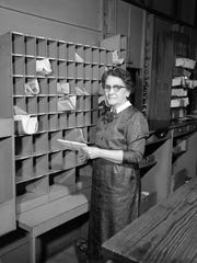 Barbara Kime McLin, postmaster in Willard in 1958