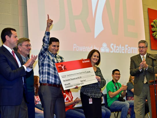 State Farm agents present a check in the amount of