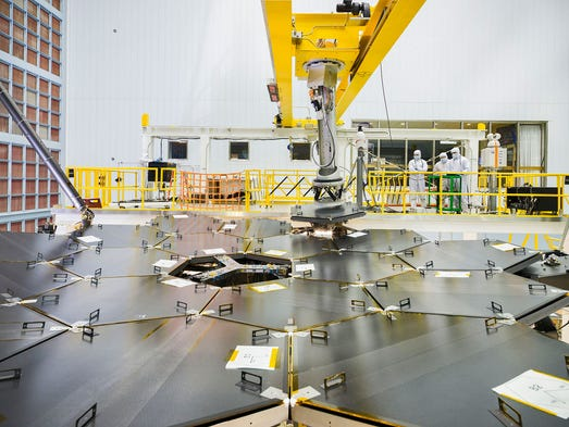 Employees from Harris Corp. are helping NASA build