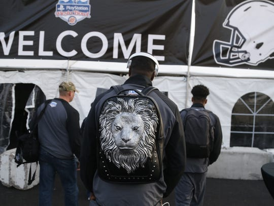 Penn State's Juwan Johnson's backup shows off a lion