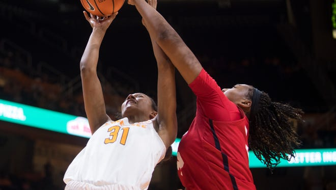 Tennessee guard Jaime Nared (31) has a shot blocked by Ole Miss forward Promise Taylor (55) during Tennessee's home basketball game against Ole Miss at Thompson-Boling Arena on Thursday, January 25, 2018.