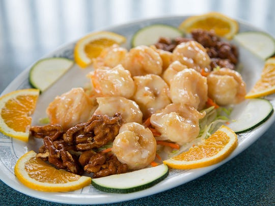 Fried shrimp served with candied walnuts and a mayonnaise-citrus