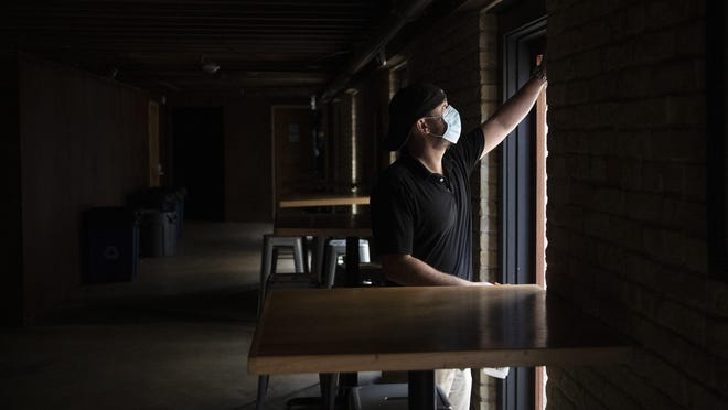 Kevin Shipp, operating partner of Cedar Street Courtyard, closes his bar on West 4th Street on Friday June 26, 2020, after Gov. Greg Abbott ordered all bars in Texas to be closed due to the coronavirus.
