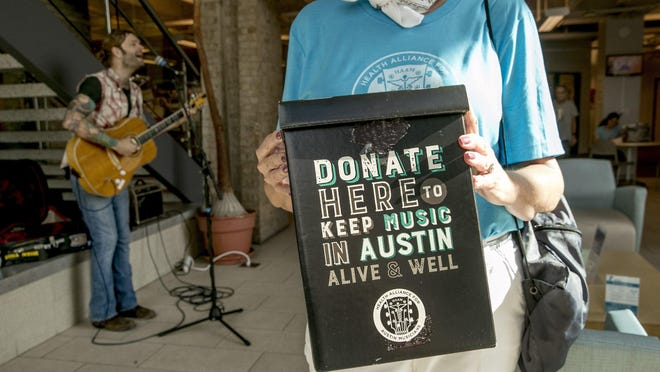 A volunteer takes donations at a 2019 HAAM Day event. The Health Alliance for Austin Musicians is facing revenue shortfalls in 2020 that could result in cutting back on services later this year.
