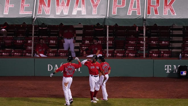 Red Sox left fielder J.D. Martinez, left, is congratulated by teammates after hitting a two-run homer against the Toronto Blue Jays in the fifth inning Tuesday night at Fenway Park.