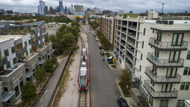 A MetroRail commuter train is shown last year traveling along East Fifth Street after leaving the Plaza Saltillo Station. Proposition A would raise property taxes to fund Project Connect, a massive expansion of Capital Metro's transit system.