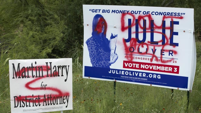 Drivers approaching Davis Lane after exiting MoPac Boulevard (Loop 1) on Monday saw these vandalized campaign signs.