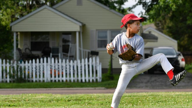 Josph Lopez delivers a pitch in this 2018 file photo from a youth baseball practice at the Von Steuben ball fields in Peoria.
