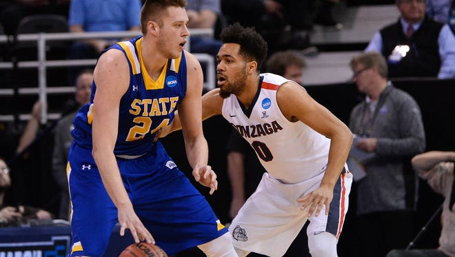 South Dakota State Jackrabbits forward Mike Daum (24) moves the ball against Gonzaga Bulldogs guard Silas Melson (0) during the first half of the first round of the NCAA tournament at Vivint Smart Home Arena.