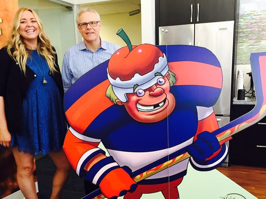 """Christine LaSorda and her father Tom with cookie character named """"The Canuck"""""""
