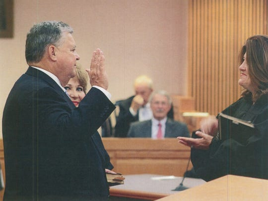 Steven Coleman Kirven is shown being sworn in by Honorable