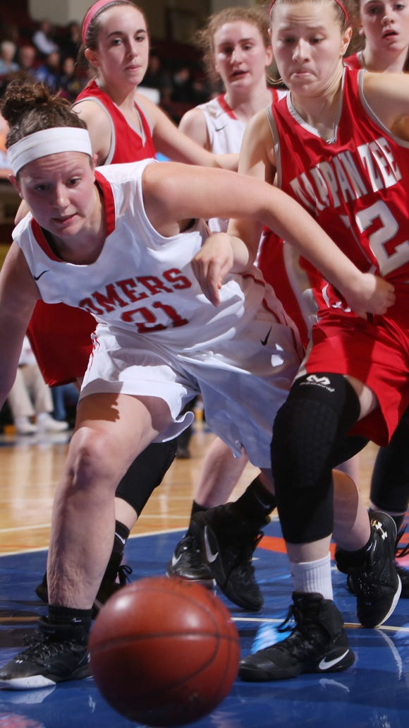 Somers' Olivia Rosenzweig (21) and  Tappan Zee's Ashley Chaluisan (12) battle for a loose ball during the girls basketball Section 1 Class A semifinal at the Westchester County Center in White Plains March 2, 2017. Somers won the game 38-18.
