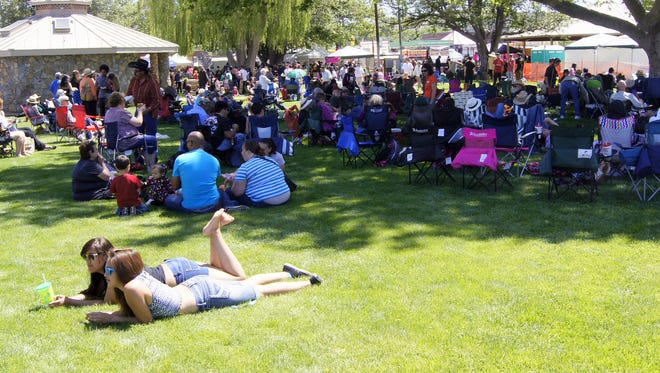 People lounge around during last year's Blues Festival in Silver City. This year's event will be a Community Celebration of Arts with the Gila Glass Classic starting things off Friday night at 5 p.m. at Gough Park.