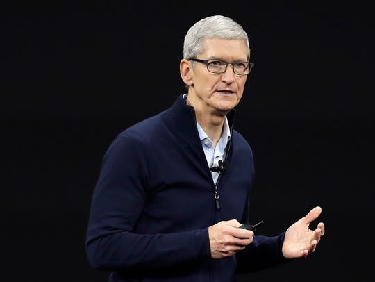 In this Sept. 12, 2017, file photo, Apple CEO Tim Cook,