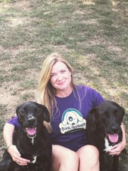 Friends of Bark Springs Chairwoman Molly Jennings of Smyrna poses with her babies, Janet and Ruby (named for the Jackson family).