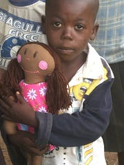 Whimsy was left with this girl, who is the daughter of a widow recently helped by Heart of Whimsy. This girl used a piece of wood as her doll to play with before being given a Whimsy doll.
