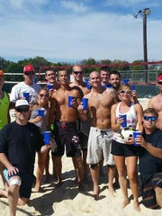 """Friends of Scecina Memorial High School volleyball coach, Brian Hawkins, gathered to play in honor of him Wednesday. Ronnie Mahlerwein, (middle, white shorts) posted this photo to Facebook. """"A lil chocolate milk for our boy... RIP BRIAN HAWKINS."""""""