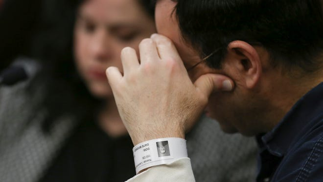 Larry Nassar averts his gaze Tuesday, Jan. 16, 2018, during the victim impact statements on the first day of his sentencing hearing. The former the former sports medicine doctor pleaded guilty to sexually assaulting seven women in Ingham County and will be sentenced after four days of victim statements.