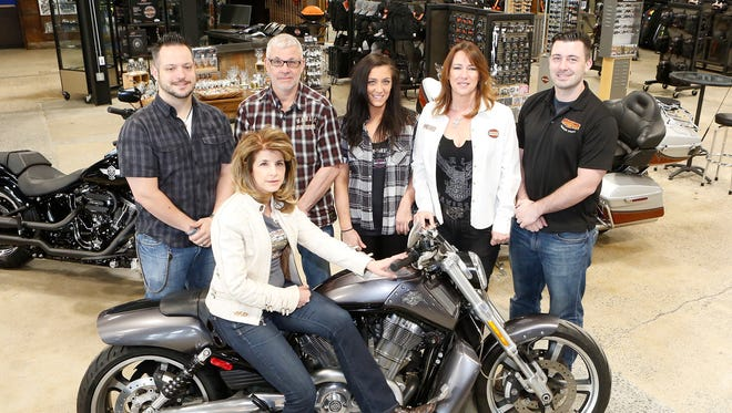 From left, Joe Bamberger, Phil DiGennaro, Sr., Lexi DiGennaro, Liz DiGennaro, Phil DiGennaro, Jr., and in front, Barbara Buccola on the showroom floor at Hudson Valley Harley-Davidson in Nanuet on Friday, April 29, 2016.