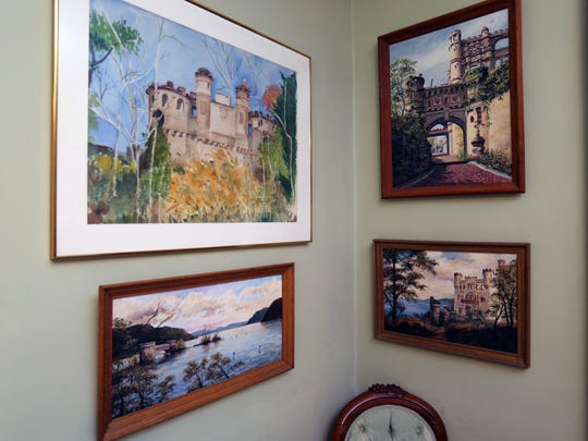 Paintings and watercolors of Bannerman Castle and Island line the walls at the Swann Inn of Beacon, in Beacon photographed Aug. 8, 2017.