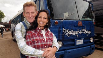 Joey, front, and Rory Feek of Joey + Rory pose by their 1955 tour bus at the 2009 Country Thunder USA music festival in Twin Lakes, Wisc.