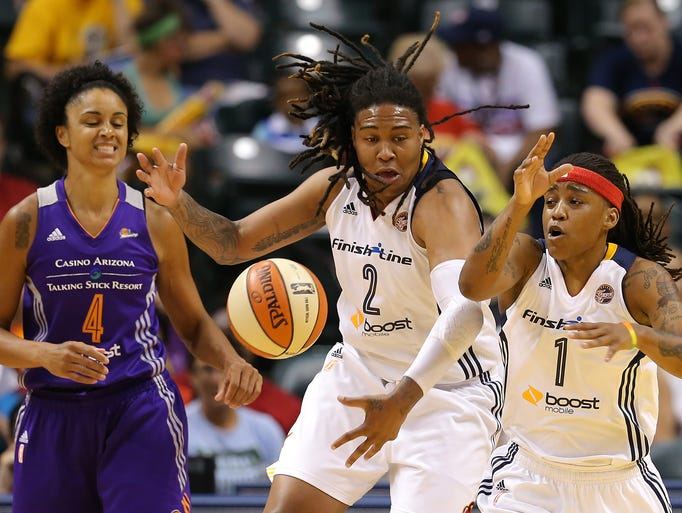 Indiana Fever's Shavonte Zellous (1) and Erlana Larkins (2) go after a loose ball against the Phoenix Mercury inside Bankers Life Fieldhouse, Friday, June 27, 2014, in Indianapolis. Phoenix won the game 81-76.
