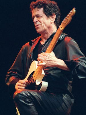 Lou Reed, of the Velvet Underground, plays in Sydney, Australia in 2000.