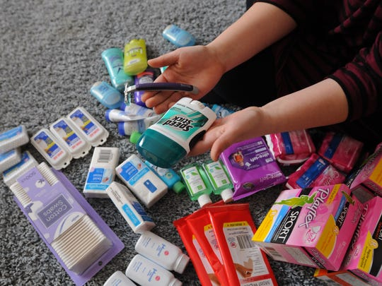 Landmark Academy student Macy Wurmlinger, 17, shows some of the toiletry items she has collected for the homeless Sunday, Feb. 14, at her home in Port Huron.
