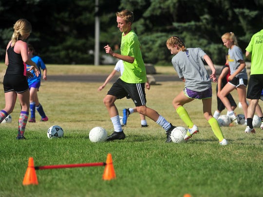 Gavin Groshelle does ball drills while training with Grassroots Soccer Development at Lions Park.